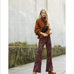 FREE PEOPLE PAISLEY PRINT KNIT FLARE STRETCH PANTS